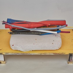 TUNINGSTAKES (DIALUNA) 27.25 x 15.25x13 in. Collected Wood, Flashe Paint, T-Shirt (1999), Cushion, Gold Leaf. 2015